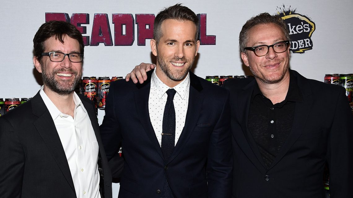 """NEW YORK, NY - FEBRUARY 08:  (L-R) Rhett Reese, Ryan Reynolds, and Paul Wernick attend the """"Deadpool"""" fan event at AMC Empire Theatre on February 8, 2016 in New York City.  (Photo by Dimitrios Kambouris/Getty Images)"""